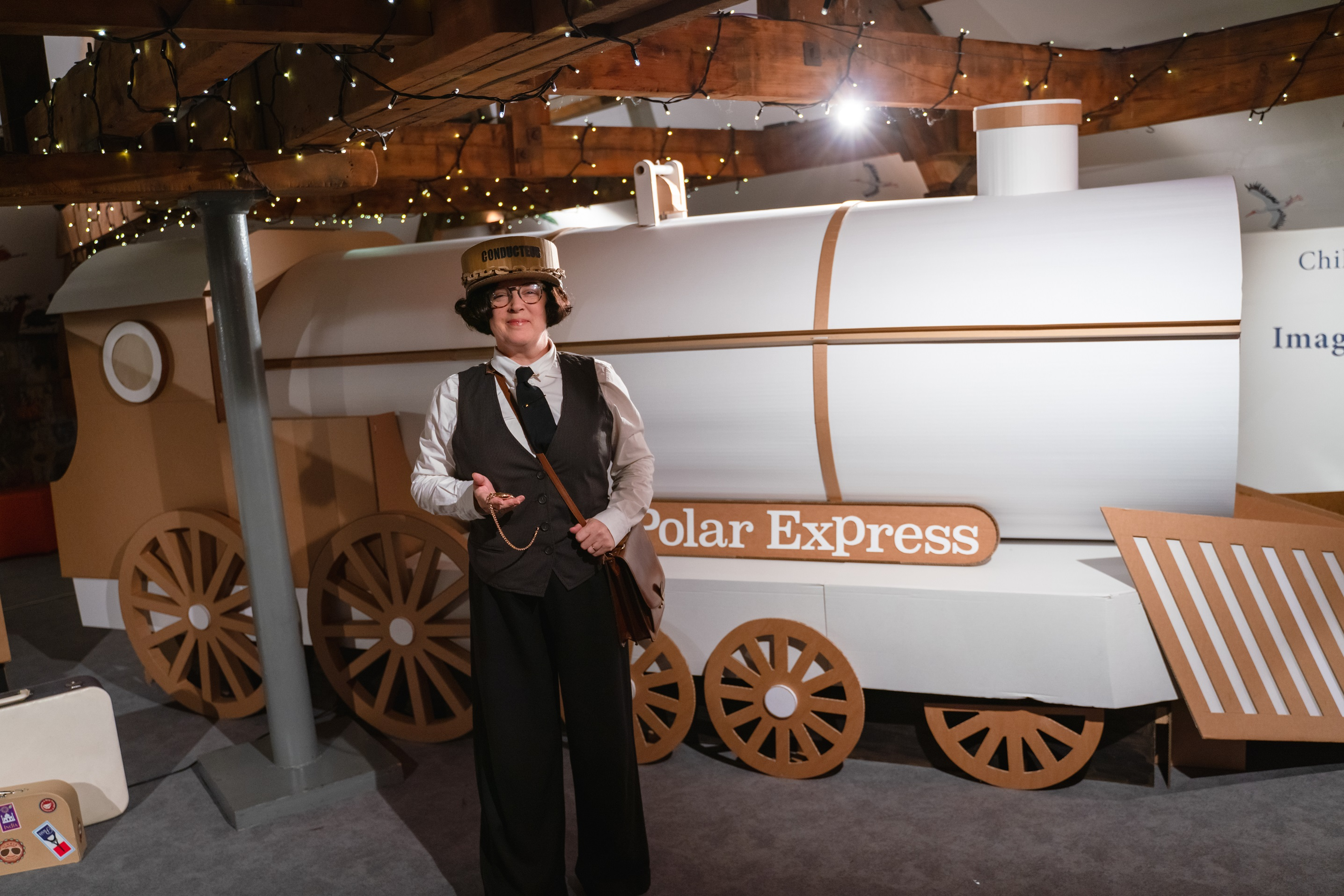 Seven Stories conductor with The Polar Express at Seven Stories.
